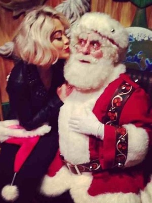 Rita Ora visits Santa's grotto in Macy's department store New York. (9 December 2013).