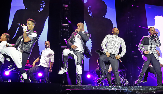 JLS - JB Gill, Ortise Wiliams, Marvin Humes, Aston Merrygold -performing on their 'Evolution' Tour at Liverpool Echo Arena. 12/09/2013. Liverpool, United Kingdom
