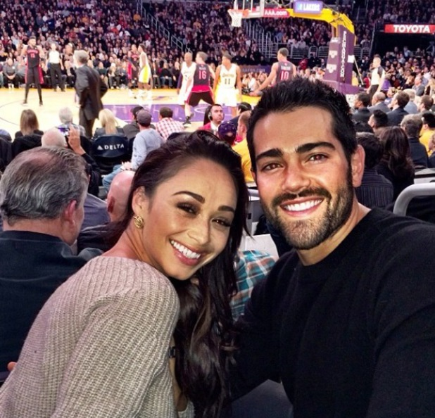Jesse Metcalfe celebrates birthday with fiancee Cara Santana at a basketball game in Los Angeles. (9 December 2013).
