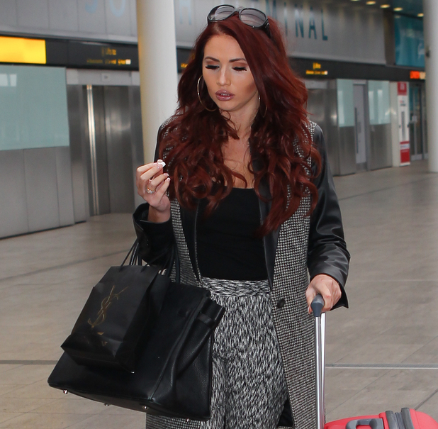 Contestant Amy Childs leaves Gatwick airport to start training in a ski resort for new reality show, Jump - 15 December 2013