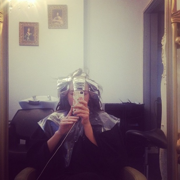 Lydia Bright snaps a picture while at the hairdresser in London - 9 December 2013