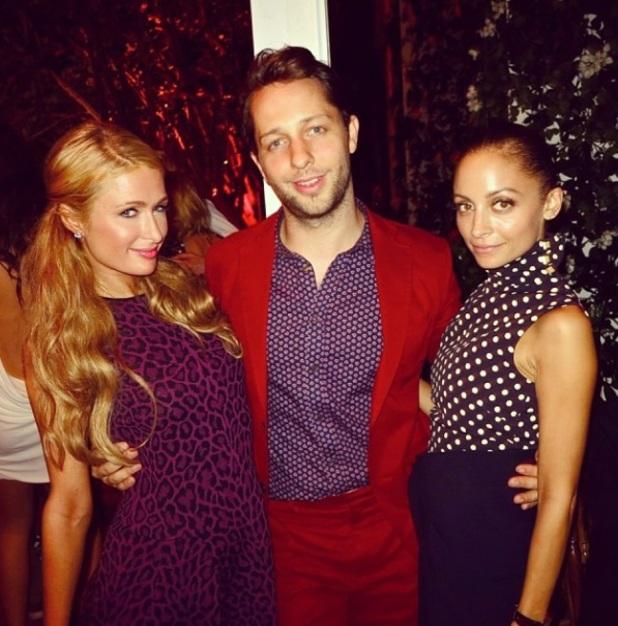 Paris Hilton and Nicole Richie pose with Derek Blasberg in Miami, 6 December 2013