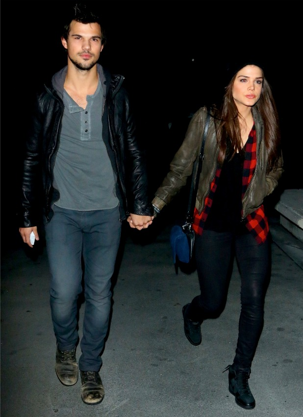 Taylor Lautner and Marie Avgeropoulos arriving holding hands to the Jay Z concert at Staple Center, 9 December 2013