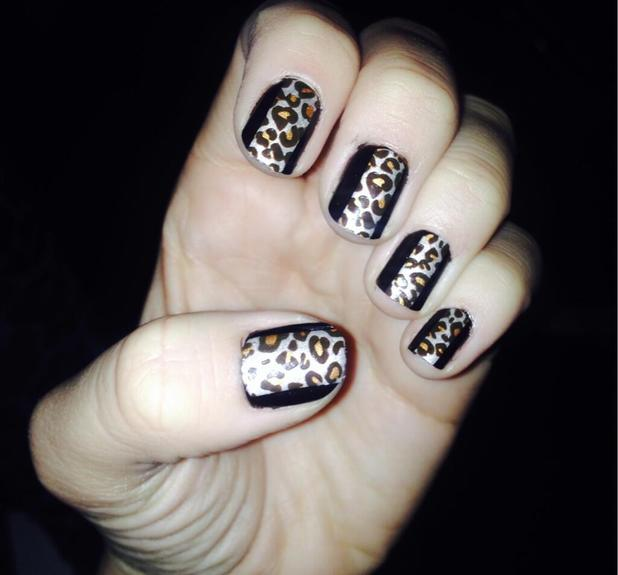 Lydia Bright shows off her black and leopard print nails using polish and Kiss Nail Wraps