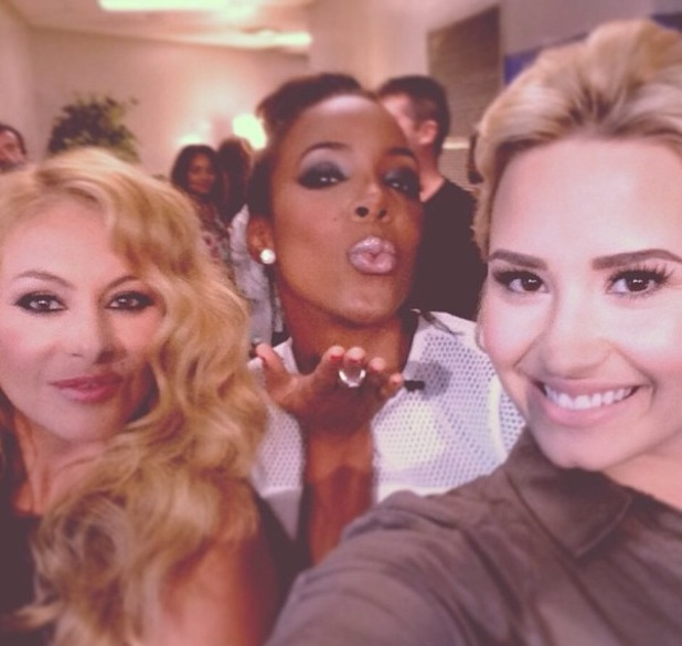 Demi Lovato with fellow X Factor USA judges Kelly Rowland and Paulina Rubio