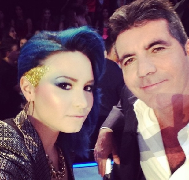 Demi Lovato with fellow X Factor USA judge and show boss Simon Cowell.