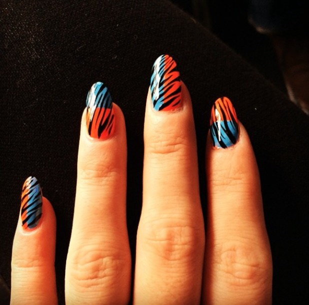 Lily Allen's blue and red/orange zebra print nails as created by Michelle Humphrey, 17 December 2013