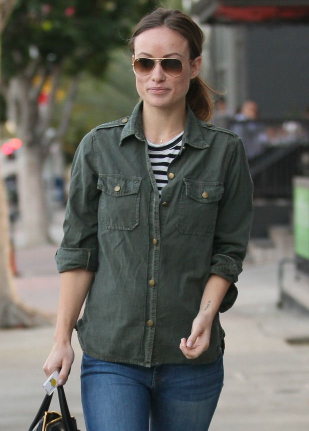 Olivia Wilde leaving lunch at Cafe Gratitude holding her baby bump and a Miu Miu handbag, 16 December 2013