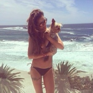 Cheryl Cole posts super-cute picture of her and pooch from her festive holiday, 28 December 2013