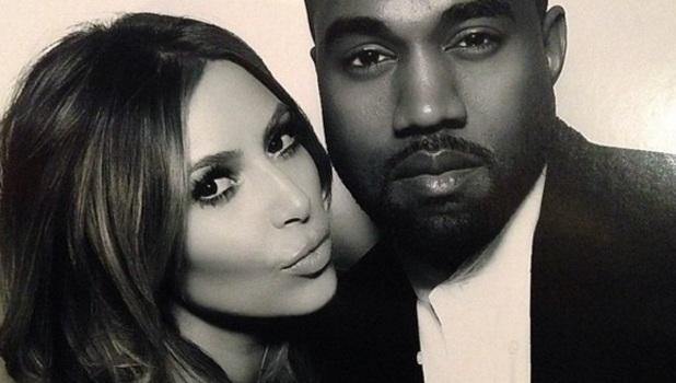 Kim Kardashian and Kanye West pose in photobooth on Christmas Eve 2013