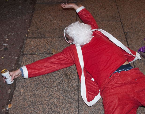 Drunk Santa lying passed out on the ground stock image