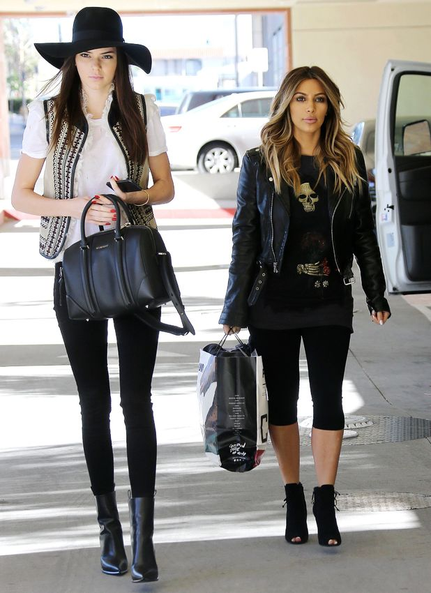 Kim Kardashian and Kendall Jenner visit a children's hospital on Christmas Day in Los Angeles, 25 Dec 2013