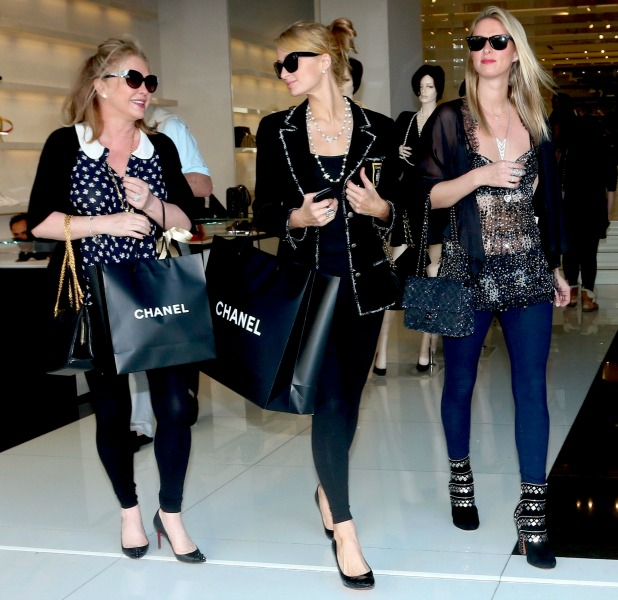 Paris and Nicky Hilton and their mother Kathy do some last minute Christmas Eve shopping, 24 December 2013