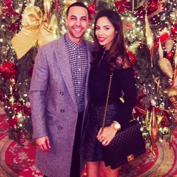 Rochelle and Marvin Humes cosy up by a Christmas tree, Dec 2014