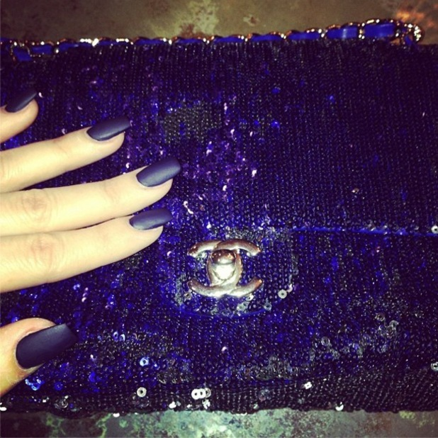 Khloe Kardashian matches her matte blue nails to her Chanel handbag - 2 January 2014