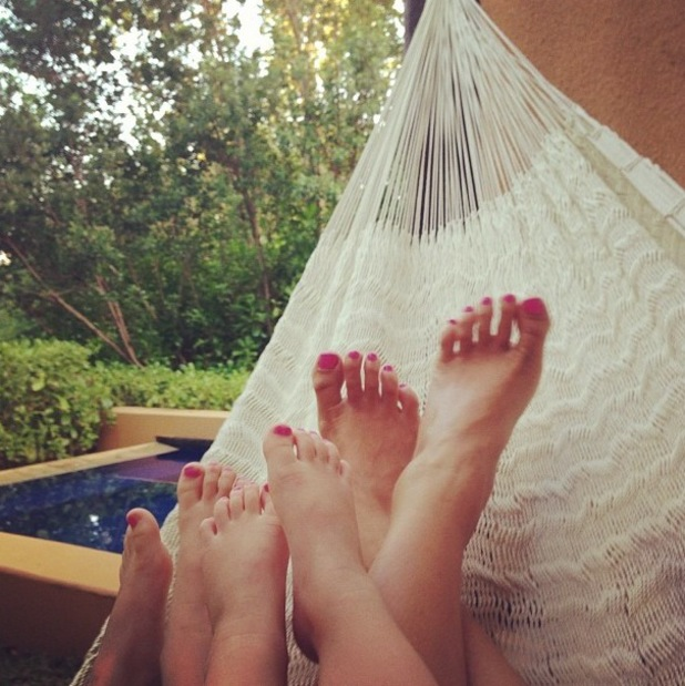 Myleene Klass relaxes in a hammock in Mexico with her daughters Ava and Hero - 2 Jan 2014