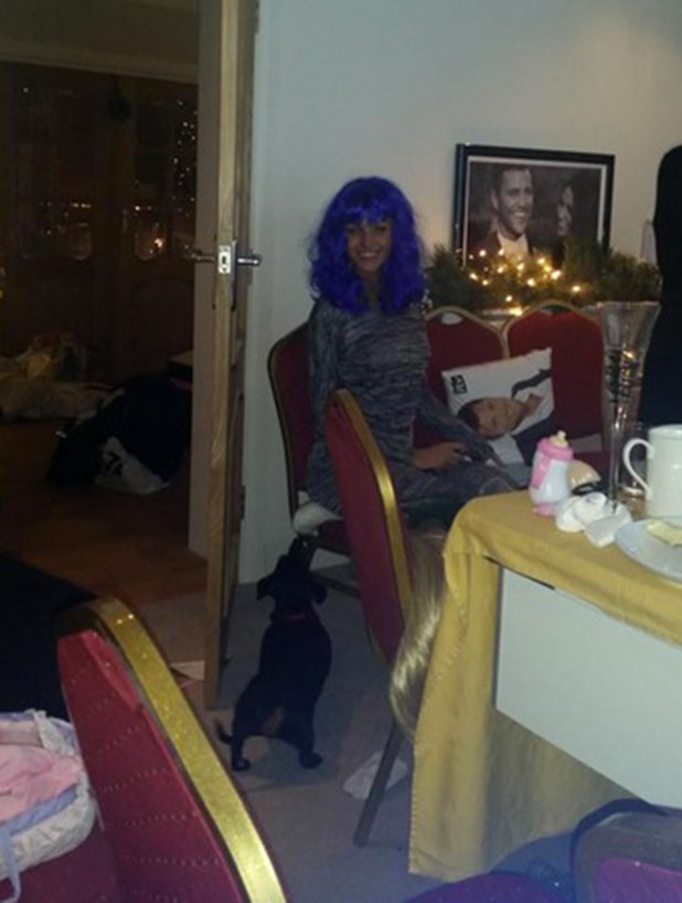Michelle Keegan wearing a blue wig and sitting next to what appears to be a Mark Wright cushion, 25 December 2014