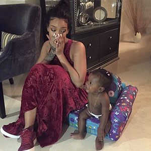 Rihanna plays with baby relative Majesty in Barbados, December 2014