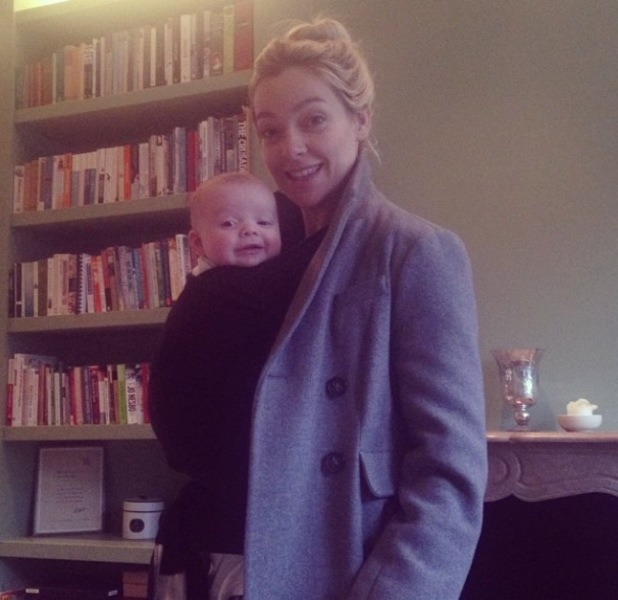 Cherry Healey pictured with baby son Edward Bear in a sling- 9 January 2014