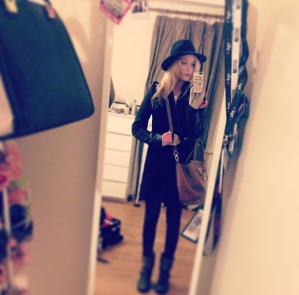 Laura Whitmore takes an Instagram picture while wearing a Maje coat - 6 January 2014
