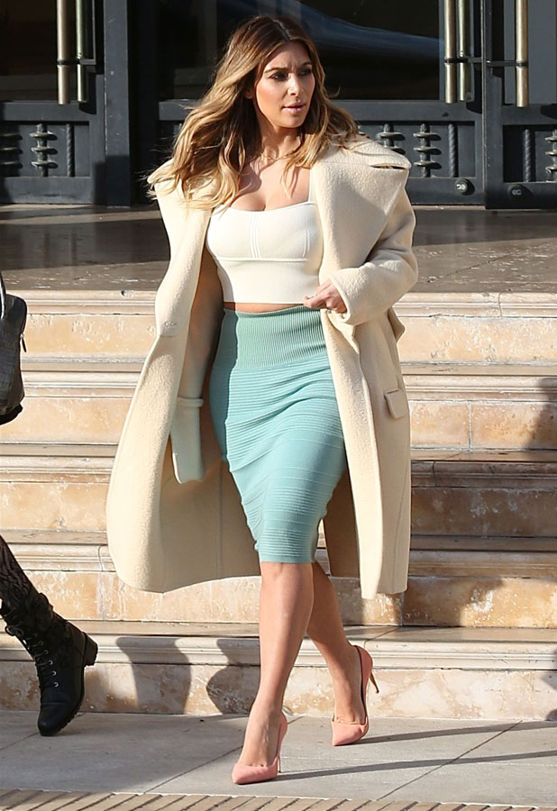Kim Kardashian shows off her cleavage as she departs Barneys New York after shopping with a friend, 6 January 2014