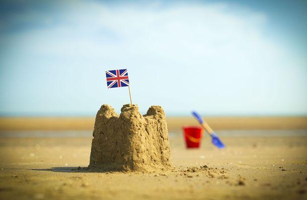 VARIOUS British flag in sandcastle on beach 2013