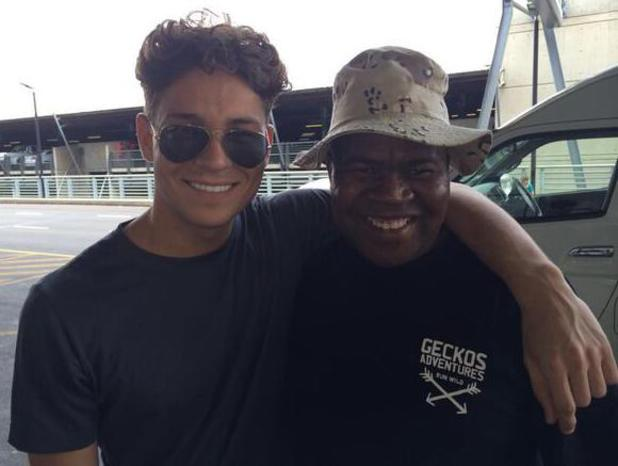 TOWIE's Joey Essex poses with a tour guide on a trek in Africa. (14 January 2014).