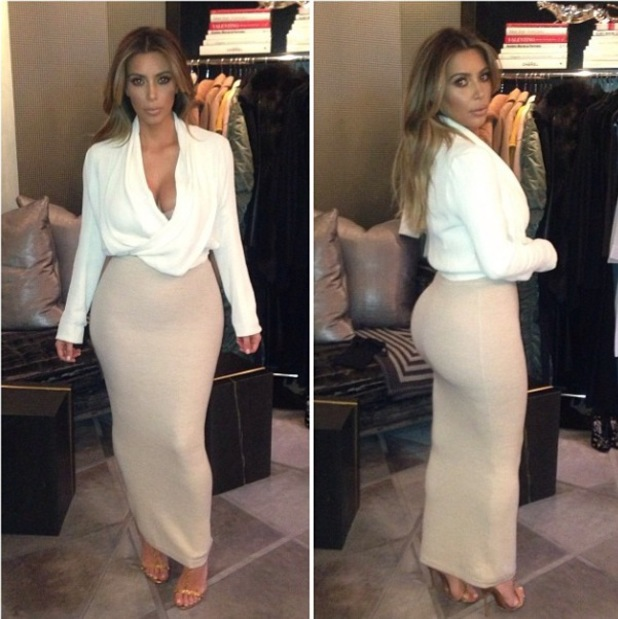 Kim Kardashian shows off her famous bottom while choosing an outfit for The Ellen Degeneres Show - 17 January 2014