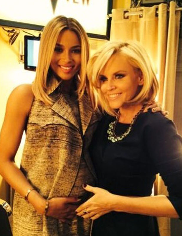 A pregnant Ciara poses with The View co-host Jenny McCarthy after confirming her pregnancy on The View, 14 January 2014