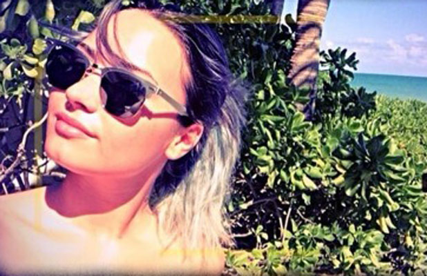 Demi Lovato tweets picture of herself with silver hair while on holiday, 15 January 2014