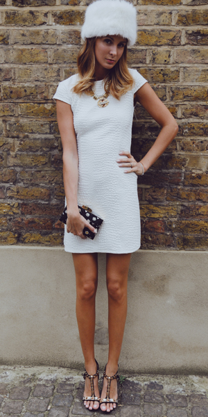 Millie Mackintosh in white dress and fur hat Miss Selfridge
