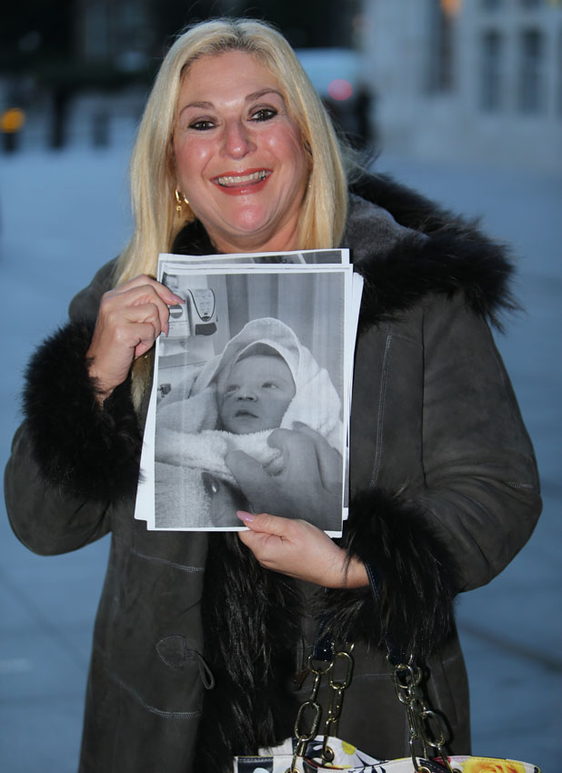 Vanessa Feltz, who has recently become a grandmother, holds up a picture of her daughter's new baby as she arrives at the BBC Radio 1 studios, 14 January 2014