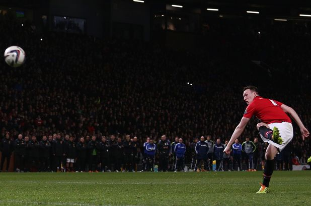 Phil Jones of Manchester United fails to score from his penalty kick in the League Cup game against Sunderland on 22/01/14