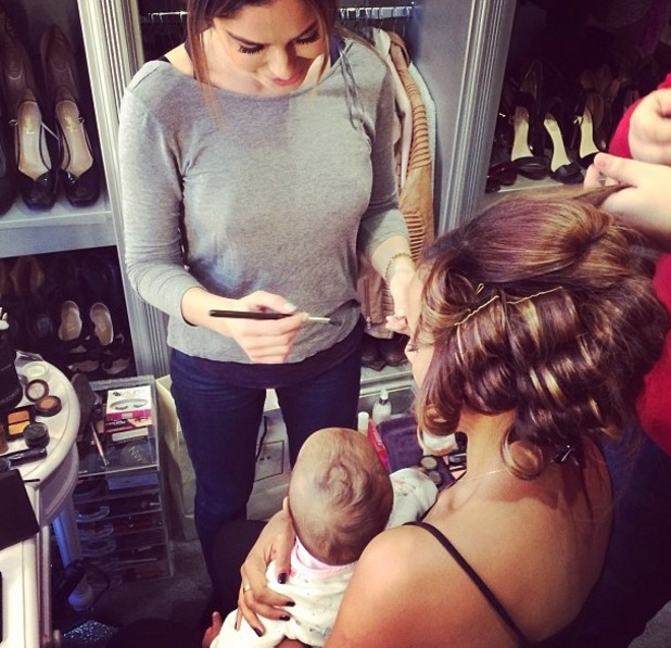Rochelle Humes has her hair and make-up done holding Alaia, before the National Television Awards, 22 January 2014