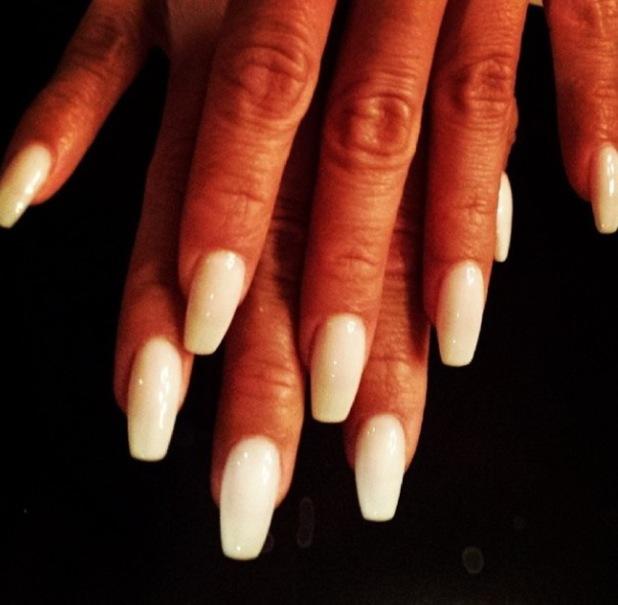 Nicole's white nails