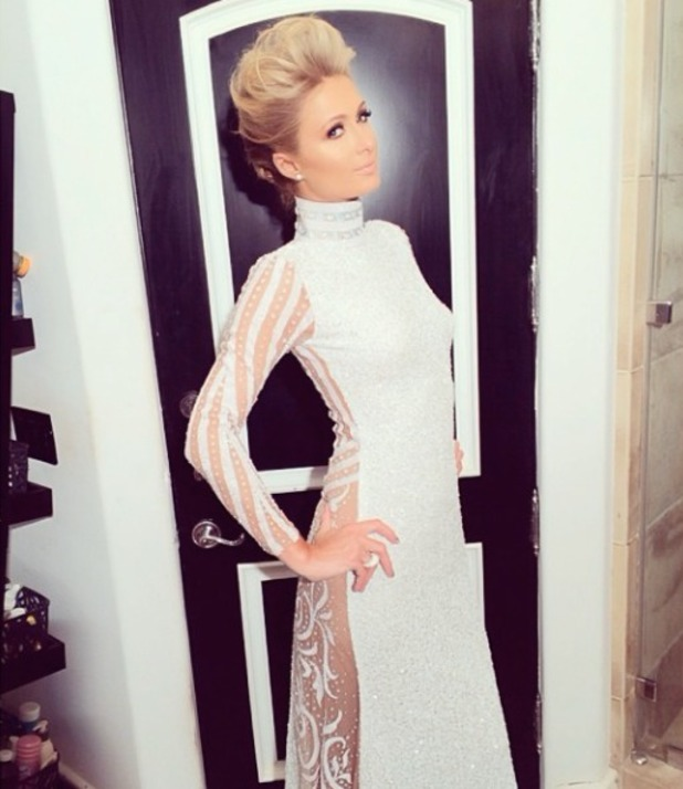 Paris Hilton shows off her beautiful white Haus of Milani gown pre-Grammys, designed by Xtina Milani, 26 January 2014