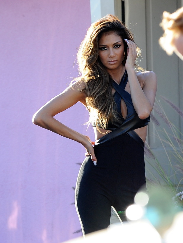 Nicole Scherzinger spotted posing for a photoshoot in Sunland Ca. The singer was seen wearing different sexy outfits for the racy shoot at the famous Cadillac Pink Motel.