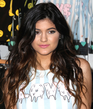 Kylie Jenner and Kendall Jenner attend the launch of the Kendall & Kylie Holiday Collection at Glendale Galleria, 9 November 2013