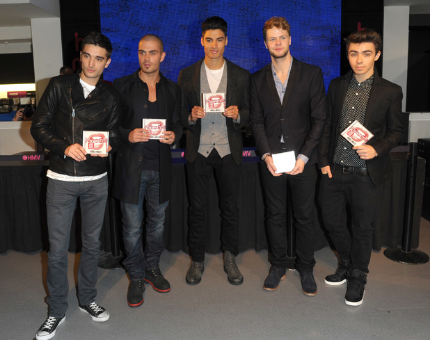 Tom Parker, Max George, Siva Kaneswaran, Jay McGuiness, Nathan Sykes - The Wanted sign copies of their latest album entitled 'Word Of Mouth' at HMV Oxford Street 11/08/2013. London, United Kingdom.