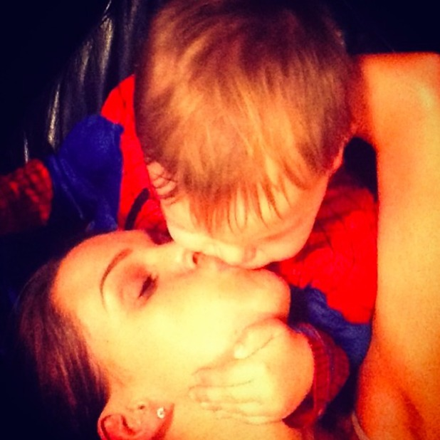 Danielle O'Hara gets kisses from son Archie, 31 January 2014