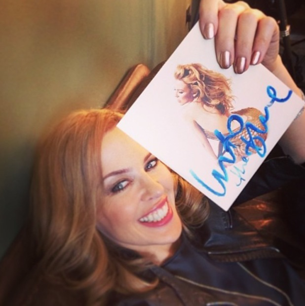 Kylie Minogue poses with promo CD of 'Into The Blue'.