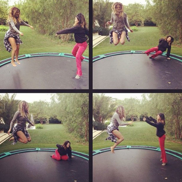 Kylie Jenner and Khloe Kardashian jumping on a trampoline, 4 February 2014