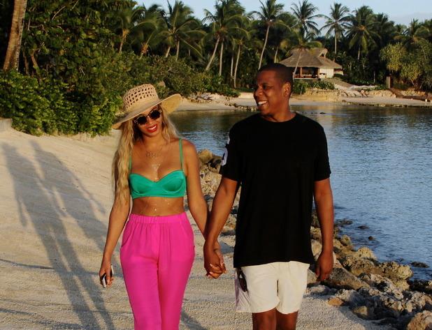 Beyoncé and Jay Z on a beach on holiday - February 2014