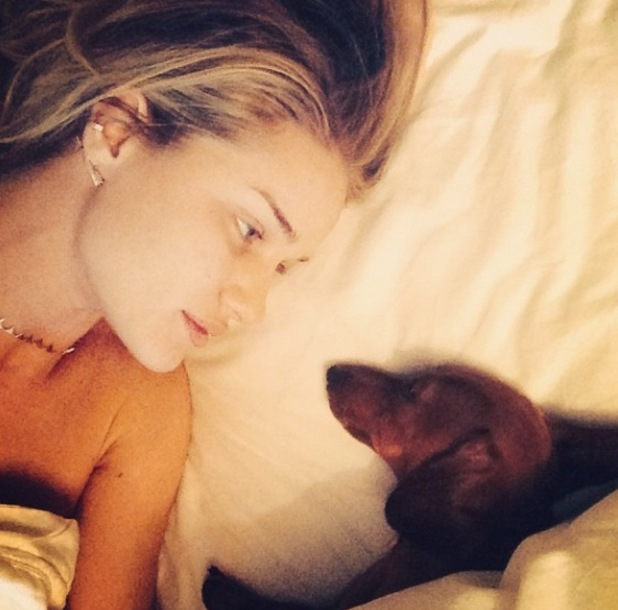 Rosie Huntington-Whiteley in bed with pet dog - February 2014