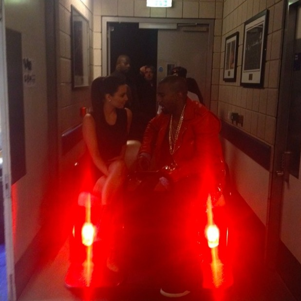 Kim Kardashian posts photo of her and Kanye West on 2014 Valentine's Day behind the scenes of his Yeezus tour