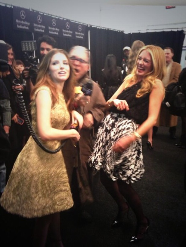 Anna Kendrick photobombs Cat Deeley while backstage at the Monique Lhuillier show at New York Fashion Week - 8 February 2014