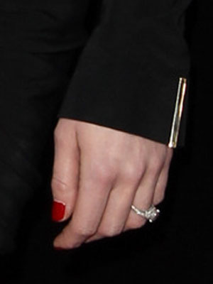 Amber Heard flashes engagement ring at the premiere of 3 Days To Kill, Los Angeles, 12 February 2014