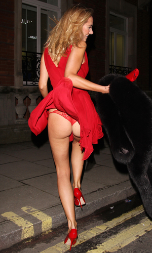 Kimberley Garner gets cheeky after wind blows up her skirt ...