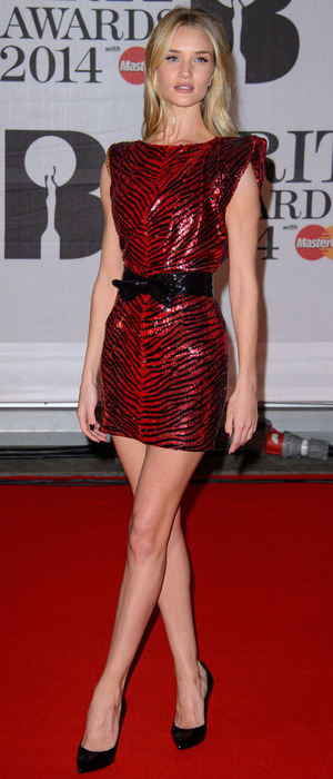 Rosie Huntington-Whiteley poses on the red carpet at the Brit Awards - London, 19 February 2014