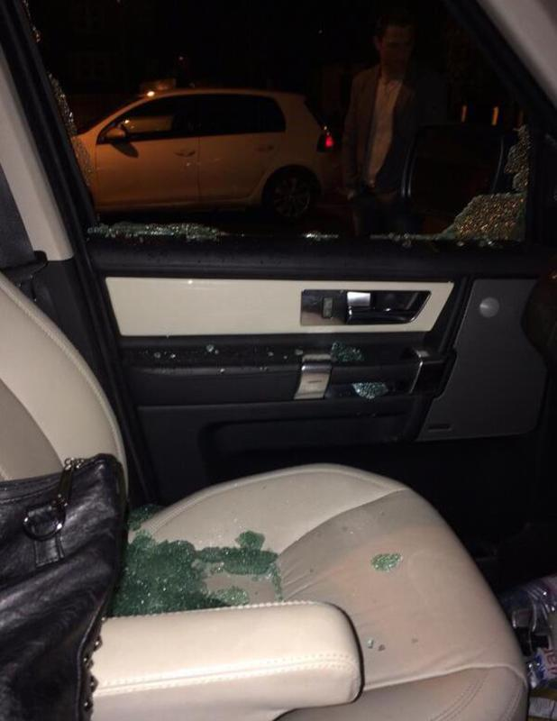 Katie Price posts picture of car window after thieves break in and steal her handbag, 21 February 2014